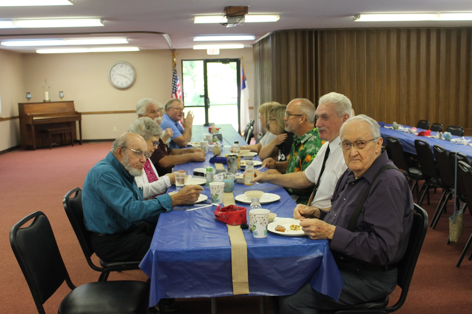 church members gathering at a table for a meal girard il